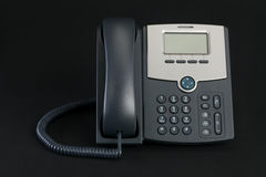 VOIP Phone Isolated on Black Background Stock Images