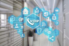 VOIP on the touch screen with a blur background of the office.Th. E concept of Voice over Internet Protocol Stock Photos