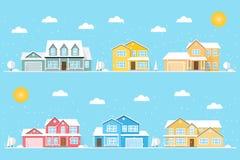 Voisinage avec des maisons et des flocons de neige illustrés sur le fond bleu Photos libres de droits