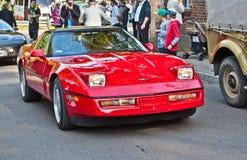 Voiture classique de Chevrolet Corvette d'Américain à un salon automobile Image libre de droits