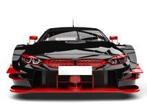 Voiture de course foncée étonnante avec les détails rouges - tir de plan rapproché de vue de face illustration stock