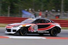 Voiture de course professionnelle de Mazda RX8 sur le cours Images libres de droits