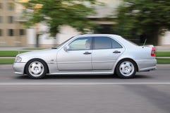 Voiture de Mercedes avec le conducteur Images libres de droits