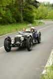 Voiture de Riley roulant en course de Mille Miglia Images libres de droits
