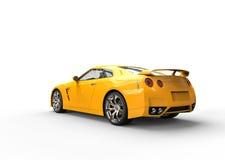 Voiture de sport jaune sur le fond blanc - vue arrière Photo libre de droits