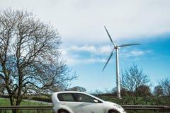 Voiture et moulin à vent Images stock