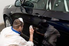 Voiture noire polie Photographie stock libre de droits