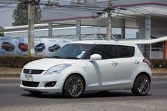 Voiture privée Suzuki Swift de ville d'Eco Photographie stock libre de droits