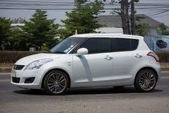Voiture privée Suzuki Swift de ville d'Eco Photo stock