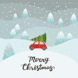 Voiture rouge avec l'arbre de Noël Photo stock