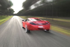 Voiture rouge et vitesse Photos stock