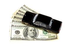 Voiture sur la pile de dollars Image stock