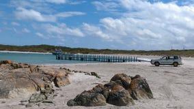 Voiture sur la plage Photos stock