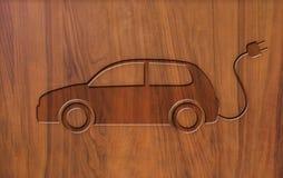 Voitures électriques de signe sur le bois Images stock