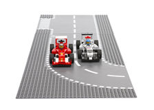 Voitures de course de Lego Ferrari F14 T et de McLaren Mercedes Photos stock