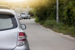 Voitures sur la route par l'embouteillage Photos libres de droits