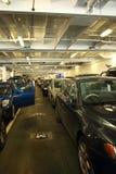 Voitures sur un croisement de ferry Photos stock