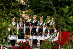 Vojvodina, Serbia-June 16, 2019: Nine young girls in traditional folklore costumes stock images