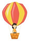 Vol asiatique de femme dans le ballon à air chaud Photographie stock