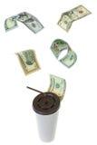 Vol d'argent de billet de banque du dollar d'USD au-dessus de tasse de livre blanc pour le coffe Photo libre de droits