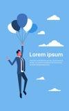 Vol d'homme d'affaires sur des ballons à air Photographie stock libre de droits