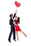 Vol d'homme et de femme, fond blanc Photo stock