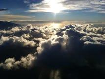 Vol de coucher du soleil de ciel de nuage Image libre de droits