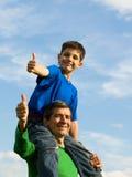 Vol de famille dans les nuages Image stock