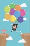 Vol de femme d'affaires par des ballons à travers la falaise de dessus d'espace Images libres de droits