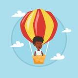 Vol de jeune femme dans le ballon à air chaud Photos libres de droits