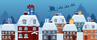 Vol du père noël avec le traîneau de renne et le grand boîte-cadeau sur le toit Joyeux Noël et bonne année Images stock