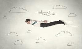 Vol gai d'homme d'affaires entre les nuages tirés par la main de ciel Photographie stock libre de droits