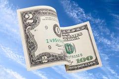 Volado encima de dólares Foto de archivo