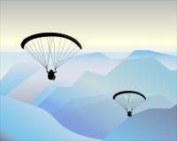 Volando nelle montagne su un aliante Fotografia Stock