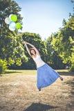 Volando via con i palloni Fotografia Stock