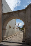 Volanic stone arch and alley in Arequipa, Peru. Volanic stone arch and alley in Arequipa, famous travel destination and landmark in Peru, with Volcano El Misti Stock Photography