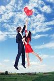 Volant sur des ballons dans le ciel, teinté Images libres de droits