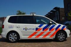Volante della polizia olandese (Volkswagen Touran) - politie di Nationale immagine stock libera da diritti