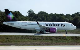 Volaris Airbus 320 taking off CUN Cancun Mexico royalty free stock photo