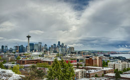 Volatile Spring Skies over Seattle Skyline. The Clouds Begin to Part above the Seattle Skyline in Spring Stock Photos