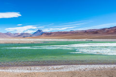 Volcan Pilli and a frozen lake with turquoise water. San Pedro de Atacama - Chile stock images