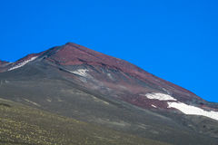 Volcan slope covered with ash. Volcan slope covered with gray ash and red lava rocks Stock Images
