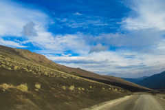 Volcan slope covered with ash. Volcan slope covered with gray ash and unparved road Stock Photography