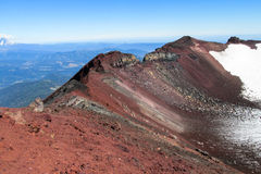 Volcan slope covered with old red lava rocks Royalty Free Stock Photos