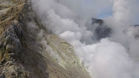 Volcanic activity on Kamchatka: thermal, fumarole field in crater of active Mutnovsky Volcano. Eurasia, Russian Far East
