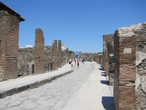Sweltering heat rises over the ruins of Pompeii in Italy. Volcanic ash, broken buildings, shattered columns and stone streets are all that`s left in the ruins stock photo