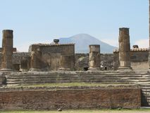 Sweltering heat rises over the ruins of Pompeii in Italy. Volcanic ash, broken buildings, shattered columns and stone streets are all that`s left in the ruins royalty free stock image