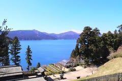 Volcanic Ashi lake and sacred mount Fuji, Hakone, Japan. Beautiful landscape with volcanic Ashi lake and sacred mount Fuji, Hakone, Japan stock images
