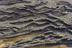 Volcanic background. Red volcanic tuff rock background texture in el Golfo lagoon on Lanzarote Island , Canary Islands Spain Stock Photos