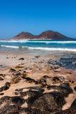 Volcanic basalt rocks on the beach, Calhau Volcano Royalty Free Stock Photo